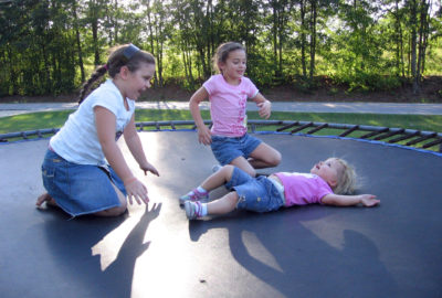 3 Girls playing on a trampoline