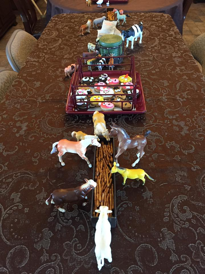 Toy animals as decorations for barnyard birthday party