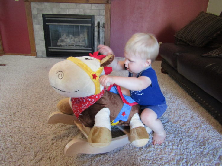 Oakely getting on rocking horse