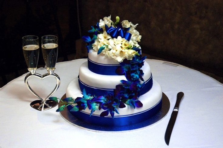 Royal Blue and White Wedding Cake with Flowers