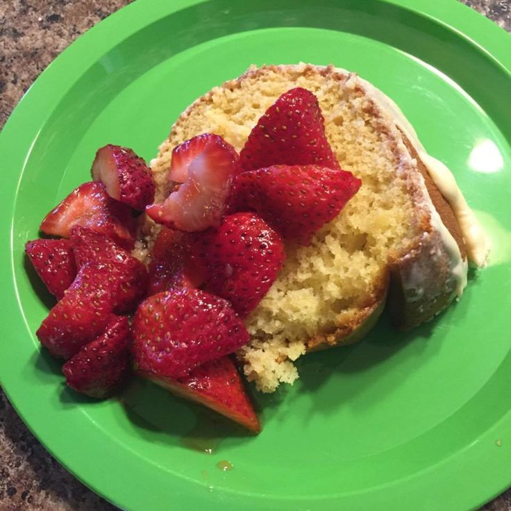 Lemon Bundt Cake served with strawberries