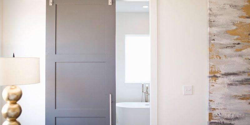 gray sliding barn door in bathroom
